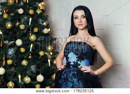Beautiful brunette girl at the festive evening