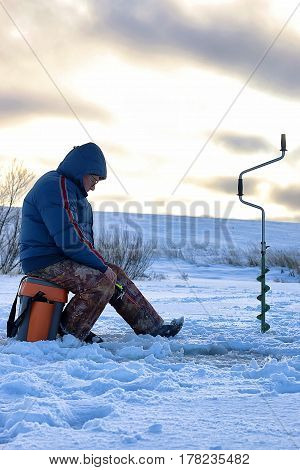 Lake in Winter and Fisherman outdoor landscape