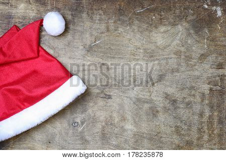 red santa hat on a textured wooden background
