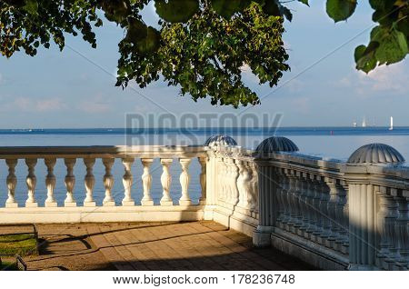 Terrace with view on the sea in the rays of the evening sun in the Palace Monplaisir in Peterhof