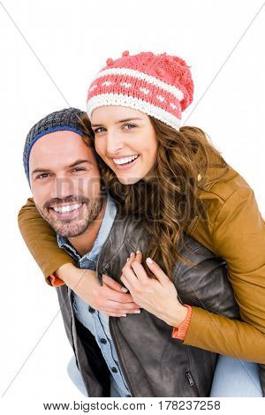 Man giving piggyback ride to woman on white background