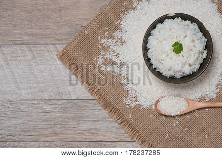 Close up of cooked rice in wooden in bowl on wooden table