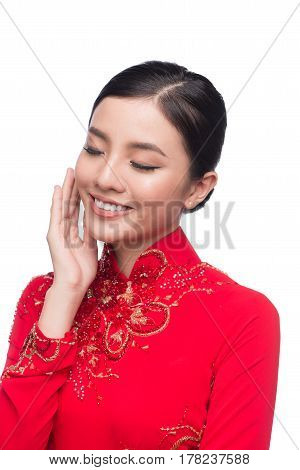 Charming Vietnamese Woman in Ao Dai Traditional Dress isolated on white.