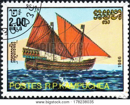 UKRAINE - CIRCA 2017: A postage stamp 2.00R printed in Cambodia shows old sailing Two-masted lateen-rigged ship series Medieval Ships circa 1986