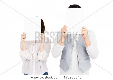 Man and woman looking at bill on white background