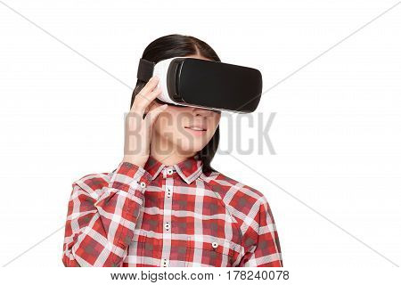 Young woman in headset of VR, spending time in virtual reality pointing by fingers and press buttons. Brunette girl making choose and playing game in cyberspace. Isolate on white.