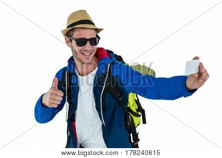 Backpacker hipster taking a selfie on white background