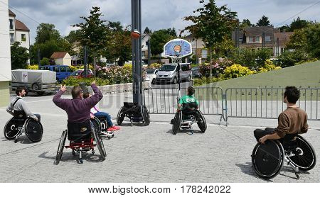 Les Mureaux France - june 18 2016 : some disabled persons play basket