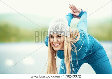 Woman Is Exercising  On The Beach
