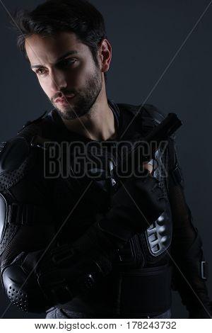 Super cops -  Handsome policeman holding a gun