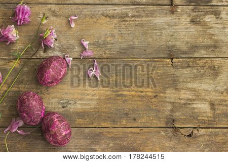 Holiday background. Easter eggs on a rustic wooden background.