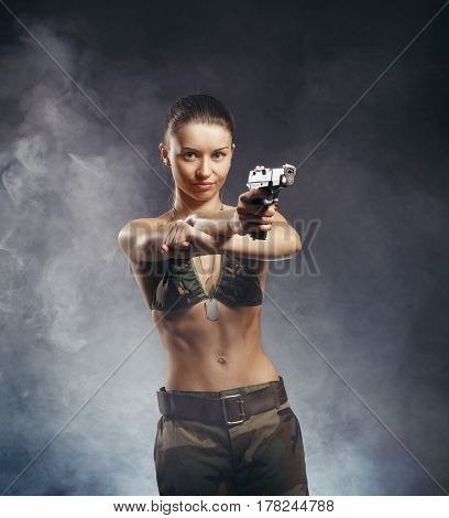Beautiful Redhead Young Woman With Gun And Military Outfit, On Smoke Background