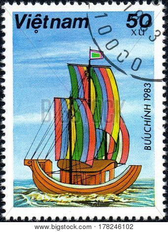 UKRAINE - CIRCA 2017: A postage stamp printed in Vietnam shows old sailing ships Sampans series Boats circa 1983