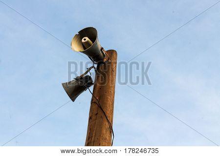 Street pillar of ancient loudspeaker. Announcement. Megaphone.