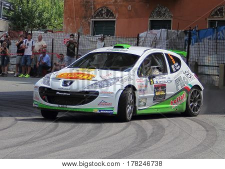 Torriglia Italy - June 06 2015-31 Rally Lantern: The Peugeot 207 conducted by the crew in the race Vellani-Filippini (Power car racing team) during the first test of speed 'of the race.