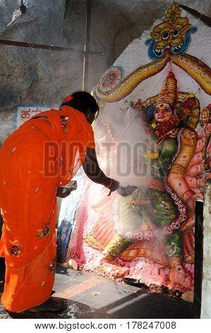 Woman Makes An Offering At A Hindu Temple At Hampi