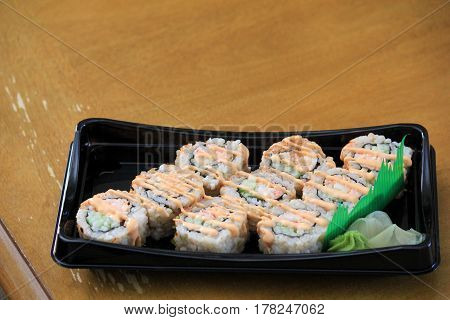 Large tray with nine pieces of freshly made sushi for dinner