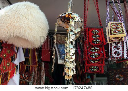 National men's and women's head dress. Handmade decorative bags. Turkmenistan. Ashkhabad market.
