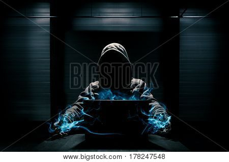 Abstract conception of hacker that takes control over laptop