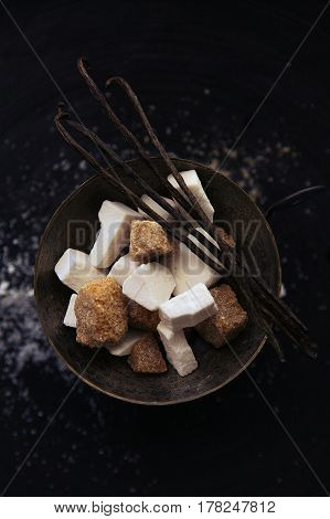 charming minimalistic still life with brown sugar, white sugar, coffee spoon and vanilla pods