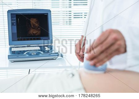 Pregnant woman undergoing ultrasound test in hospital
