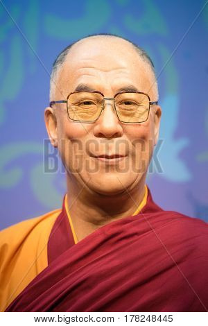 BANGKOK - JAN 29: A waxwork of Dalai Lama on display at Madame Tussauds on January 29 2016 in Bangkok Thailand. Madame Tussauds' newest branch hosts waxworks of numerous stars and celebrities