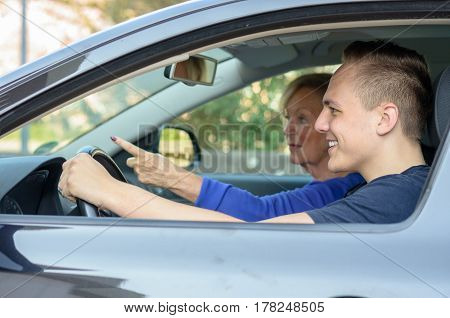 Happy Young Man Giving His Grandmother A Lift