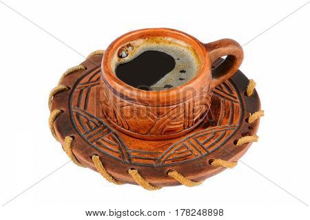 Clay cupful with coffee on a white background