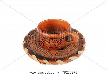 Clay cup and saucer isolated on white