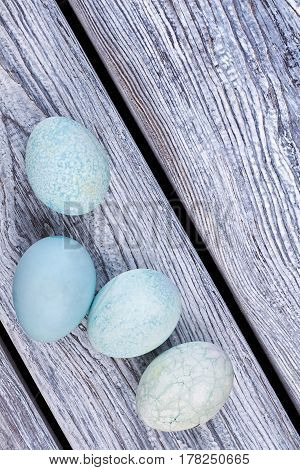 Some blue eggs. Painted eggs on wood. Topical Easter products.