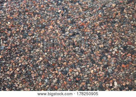 Texture of a wet stone road closeup. Stone background.