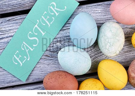 Dyed chicken eggs. Easter crafted card. Easter holiday mirth.