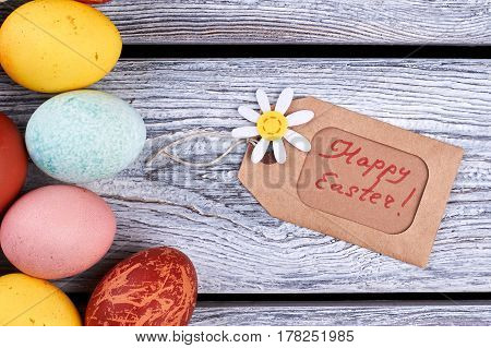 Happy Easter tag and eggs. Small felt flower. Interesting facts about Easter.