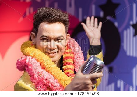 BANGKOK - JAN 29: A waxwork of Yodrak Yodrak on display at Madame Tussauds on January 29 2016 in Bangkok Thailand. Madame Tussauds' newest branch hosts waxworks of numerous stars and celebrities