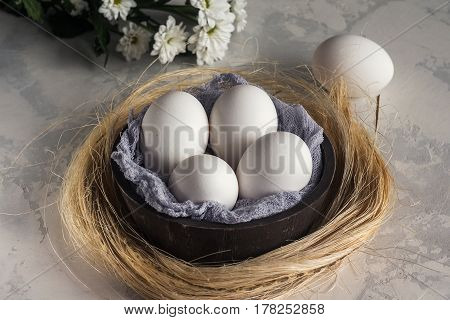 White Eggs In Wooden Bowl On White Background, Selective Focuse