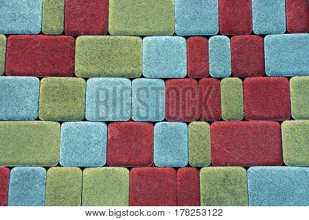 Colored stone texture of paving stones and cobblestones