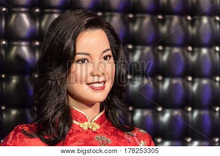 BANGKOK - JAN 29: A waxwork of Teresa Teng on display at Madame Tussauds on January 29, 2016 in Bangkok, Thailand. Madame Tussauds' newest branch hosts waxworks of numerous stars and celebrities
