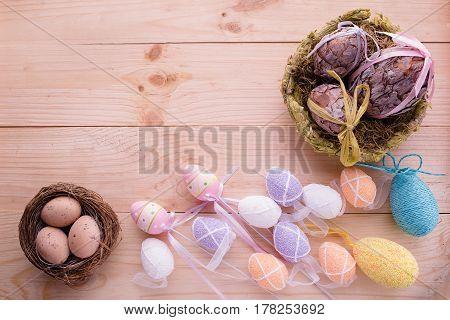 Easter eggs on lighten wooden background, easter concept