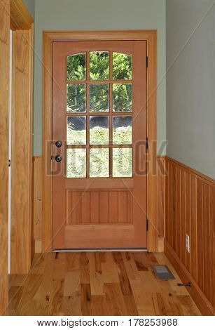 Wooden Door at  the End of a Hallway