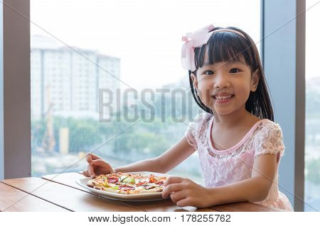 Asian Chinese Little Girl Eating Pizza Pepperoni