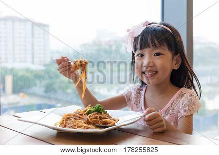 Asian Chinese Little Girl Eating Spaghetti Bolognese