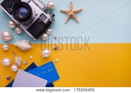 Travel Accessories On Blue And Yellow Background. Essential Vacation Items. Travel Concept, Top View