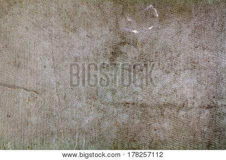 Old grey textile texture with fading and scratches. Abstract background