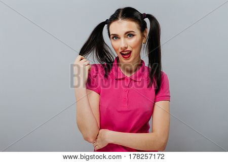 Flirting pretty girl or woman cute beautiful fashion female model with brunette hair tail with sexi pink lips and fingernails copy space isolated on white.