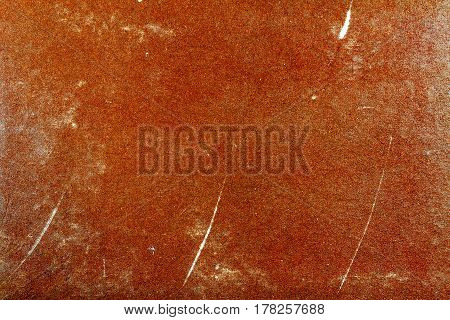 Vintage brown paper texture with scratches and fading. Abstract background