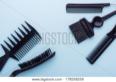 Professional Hairdresser Tools, Isolated On Cyan Paper