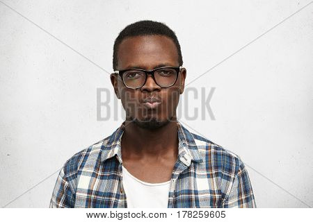 Young Dark-skinned Worker Looking Angry And Offended, Passive-aggressive And Strongly Unsatisfied, P