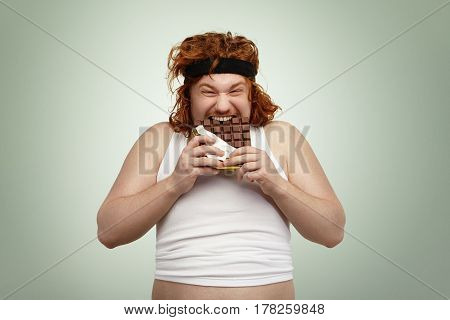 Crazy And Hungry Overweight Young Redhead European Male With Good Appetite Wearing Black Sports Bra