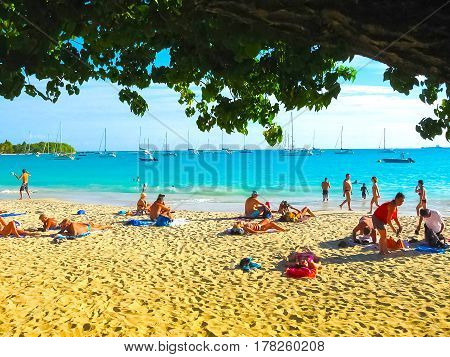 Saint Francois, Guadeloupe - February 09, 2013: The people resting at Anse Champagne beach in Saint Francois, Guadeloupe, Caribbean on February 09, 2013