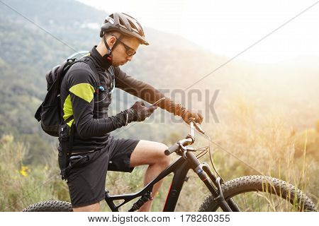 People, Sports, Active Lifestyle And Modern Technology. Outdoor Picture Of Cyclist On Booster Bike U